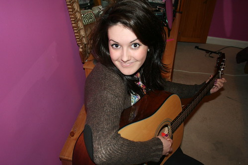 Kate with her guitar