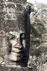 Angkor Bayon stone faces (mezzotint_de) Tags: old trip travel summer vacation holiday art tourism monument face statue rock stone architecture vintage asian temple carved ancient rocks asia cambodia cambodian looking head antique buddha rustic decoration ruin culture buddhism landmark jewelry carving historic ornament journey heads figure civilization crown spotted aged traveling angkor wat archeology mystic touristic bayon buddhistic