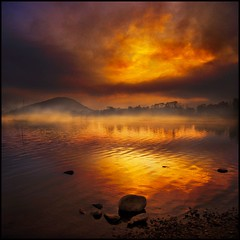 Dawns eruption (adrians_art) Tags: trees sunset sky cloud mountains water reflections boats rocks silhouettes shore cumbria ripples lakeullswater impressedbeauty