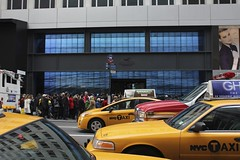 NY Taxi wave (Simone Lovati) Tags: nyc winter ny newyork yellow retail taxi wave 2011
