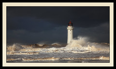 Angry sea at New Brighton. 1 (Robstorm Photography) Tags: sea lighthouse seascape storm beach sunshine rain clouds danger liverpool canon dark landscape big sand waves wind estuary rough newbrighton choppy supershot 24100 perchrock 5dmark2 robstorm