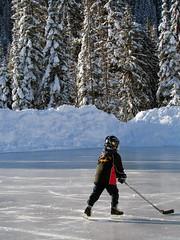 a boy a pond a puck (Vida Morkunas (seawallrunner)) Tags: park morning cold hockey frozen pond bc britishcolumbia sunny determined ambition manning hopeful cwall