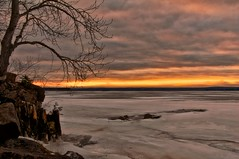 Fire and Ice (LynnF1024) Tags: winter sunset sky lake ice nature wisconsin clouds photoshop landscape aperture lakesuperior onflickr fireandice chequamegonbay ashlandwi nikond90 ashlandcounty afsdxzoomnikkor1855mmf3556gedii lynnf1024