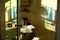 blue towel (omoo) Tags: newyorkcity art bathroom mirror apartment sink interior westvillage tub antiques collectibles furnishings greenwichvillage bluetowel medicinechest yellowtile mirroreddoor yellowbath