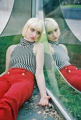 (danielbenmoyal) Tags: red film girl leaves fashion 35mm model pants blueeyes mirrors blond canonae1