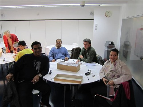 Visitors having successfully finished a box of pottery in the Hands-On Workshop