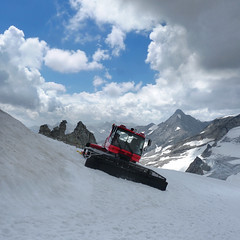 A red snowplow prepares a run at the Hintertux ski resort (Bn) Tags: world winter red summer vacation people mountain 3 snow ski alps ice nature water way geotagged austria oostenrijk waterfall back chair melting day all skiing iii year transport large down tourist panoramic best resort glacier alpine round gondola hiker alive carver peaks visitors heights gletscher snowboarder snowplough sunbather wal feelings snowplow zillertal austrian hintertux highest slopes indescribable spectacle lifts schwaz 3250m kier kabelbaan tuxertal arouse thriling hintertuxer gletscherbus gefrorenewandspitzen gefrorene towplow 10660ft geo:lon=11664886 geo:lat=47061953