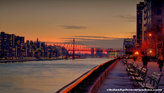 Sunset Along the East River (ImagesByRayD) Tags: park nyc longexposure bridge sunset sunlight newyork bench cityscape waterfront dusk manhattan midtown queens eastriver rooseveltisland hdr waterway 59thstreetbridge queensboroughbridge graciemansion mayorkoch canon7d edwardikoch