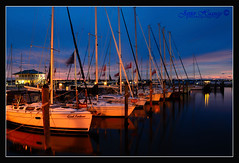 Windy night at the Marina Bradenton-Florida (Javier Huanay) Tags: light water night sailboat reflections atardecer boat agua florida javier bradenton d7000 blinkagain huanay