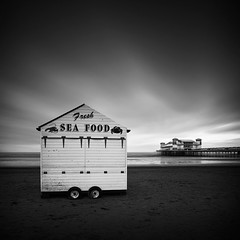 Fresh Sea Food (Andy Brown (mrbuk1)) Tags: longexposure winter sea cloud beach scale contrast square mono coast pier blackwhite seaside sand closed fastfood wheels perspective somerset shore beachhut shack desolate tones barren westonsupermare shut outofseason neutraldensity desserted nd110