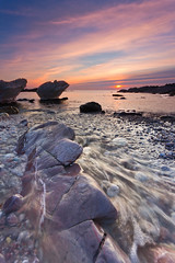 Winter Sunset (paulwynn-mackenzie.co.uk) Tags: ocean uk longexposure light sunset sea england sun seascape southwest color colour beach rock clouds composition photoshop landscape paul movement rocks colorful stream warm europe bright sony a33 pebbles brush mackenzie adobe software processing colourful alpha dslr amateur slt lightroom leadinglines wynnmackenzie