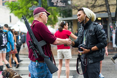Shooter to Shooter (-Dons) Tags: camera usa dog man hat canon austin gun texas unitedstates tx rifle sxsw 6thstreet
