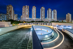 One Way (Scintt) Tags: road city blue light sky urban panorama public car skyline bulb architecture modern night hub clouds buildings photography evening jon singapore long exposure apartments glow cityscape estate slow angle bend towers wide trails dramatic surreal vehicles hour shutter housing tall curve chiang carpark mode hdb stitched toa skyscapers payoh scintillation scintt