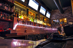 Cannery Row Brewing Company (Curtis Gregory Perry) Tags: california longexposure television bar brewing restaurant monterey tv bottle nikon drinking row shelf company alcohol booze bartender cannery d800e