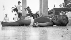Where ever I lay my hat (Keith Mulcahy) Tags: poverty sleeping bw baby monochrome asia cambodia child riverside streetphotography fujifilm keithmulcahy x100t