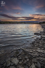 Hole (Karl Ruston) Tags: ocean sunset sea sky lake beach water clouds reflections landscape coast seaside sand rocks outdoor yorkshire shore serene
