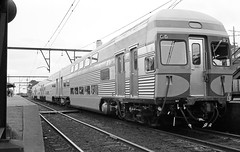 Gosford 1970: new double-decker (sth475) Tags: railroad winter urban blackandwhite bw monochrome car station electric train coach platform railway australia historic negative nsw scanned commuter emu interurban centralcoast shortnorth cityrail gosford latewinter bilevel doubledeck u13c comeng uset multipleunit vset ddiu dcfclass