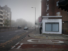 Smoker (davemason) Tags: street mist colour sunday smoker rotherhithe stanger