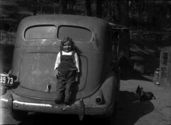 Girl Standing on Car Bumper, ca. 1945 (ChrisWarren1956) Tags: poverty california car rural vintage child farm licenseplate 1945