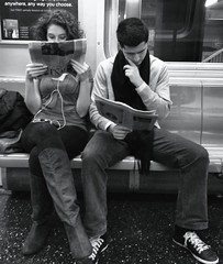 Anywhere,anyway you choose to read the paper! (Graceiee B) Tags: nyc news subway newspaper blackwhite couple sweet candid lovebirds ftrain iphone iphonography inyetsting