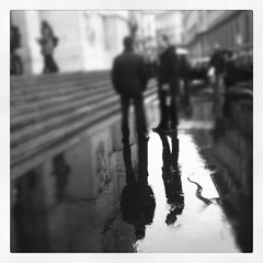 Milano h:14.14 (secondfloor - silvia izzi) Tags: people italy reflection monochrome rain milano iphoto raining pioggia borsa stockexchange ig iphone piazzaaffari