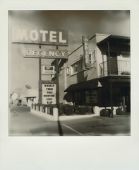 Regency Motel (Nick Leonard) Tags: old city vegas windows winter blackandwhite money building classic film monochrome sign analog vintage polaroid outside sx70 outdoors office mainstreet downtown neon doors lasvegas nevada nick motel scan retro sidewalk signage neonsign arrow weekly vacancy monthly prices landcamera polaroidsx70 px100 instantfilm epson4490 testfilm polaroidsx70landcamera polaroidsx70sonaronestep polaroidsx70sonar regencymotel integralfilm nickleonard silvershade betafilm px100uv px100testfilm