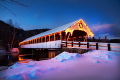 Stark Covered Bridge, Stark, New Hampshire (Robert Clifford) Tags: bridge winter sunset snow water night river frozen newengland newhampshire nh coveredbridge stark starknh 1585mm canon7d starknewhampshire robertallanclifford cliffordphotographynhcom
