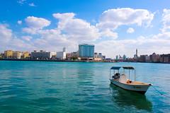 Waiting . . . (Ali Bin Abdullah) Tags: sea sky cloud canon boat dubai mm 1855 500d