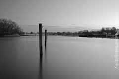 Reflecting poles (Austin Wheeler Photography) Tags: winter white black cold water boats reflecting is long exposure wind adobe poles win treens lightroom
