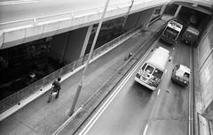 (David Davidoff) Tags: road urban blackandwhite bw monochrome cityscape human vintagecamera balance analogue moment justintime kentmerefilm flickrandroidapp:filter=none leicam3rangefinder streetpeoplelife