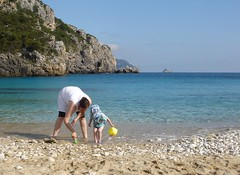 On the beach in Corfu ~ Amy and Oliver (Sibad) Tags: oliver amy greece corfu paleocastritsa