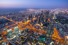 At The Top (Justin S Reid) Tags: life street city travel light sky urban sun building tower architecture night buildings landscape dubai cityscape view nightscape top towers uae east busy khalifa emirate height burj moden 500px ifttt dierjscreensaver