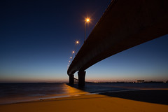 Pont de l'le de R (Michel Couprie) Tags: bridge light sea france beach water lamp architecture sunrise canon eos dawn sand pont bluehour michel plage charente aurore aube couprie