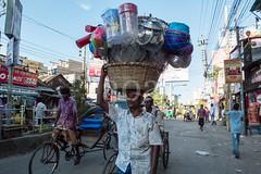 H504_3213 (bandashing) Tags: street england shopping manchester basket head transport passengers shops rickshaw bowls sylhet bangladesh bazar carry hawker socialdocumentary pans aoa bondor bandashing akhtarowaisahmed bondorpoint