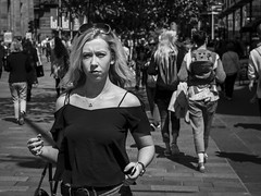 Summer In The City (Leanne Boulton) Tags: life street city uk light shadow summer portrait people urban blackandwhite bw woman sunlight white black detail texture girl monochrome beautiful beauty face look female canon 50mm mono scotland living blackwhite eyecontact pretty mood natural emotion humanity outdoor expression glasgow candid young culture streetphotography streetlife scene depthoffield human shade portraiture 7d blonde summertime feeling society tone facial candidportrait candidstreetphotography candideyecontact