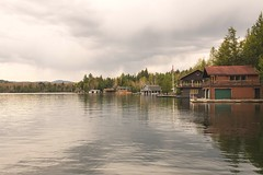 Lake Placid Boat Houses (S A F I R E) Tags: lighting trees mist lake reflection art nature water sunrise landscape fantastic nikon scenery mood glow atmosphere scapes lakeplacid safire safirephoto