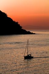 (carlosalpa) Tags: sunset sea sol beach water canon atardecer boat mar san barco sebastian tamron puesta sansebastian euskadi donostia velero 2011 450d carlosalpa blinkagain