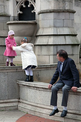 Watching the generation game  Rob Watkins 2011 (Aland Rob) Tags: street old city uk pink england people white playing man fountain wall kids canon children photography climb other birmingham sitting play sweet coat watch watching climbing help sit 5d sat moment toddlers seated each helping streettogs