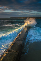 Evening breaker (snowyturner) Tags: light evening coast cornwall harbour cove jetty wave atlantic swell breaker sennen swash capecornwall