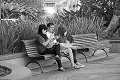 Let's communicate! 1 (vil.sandi) Tags: city people bw bench mobil communication sarawak malaysia borneo esplanade kuching
