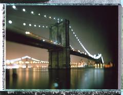brooklyn bridge (andrew c mace) Tags: nyc newyorkcity longexposure film night analog cityscape fuji bokeh manhattan brooklynbridge 4x5 monorail xl largeformat schneider cambo instantfilm v700 superangulon 72mm epsonv700 fp100c45 schneider72mmxl