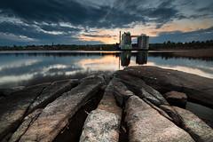 Two towers of Skattkrr (- David Olsson -) Tags: sunset lake industry water clouds reflections landscape nikon rocks factory cloudy sweden sigma cliffs 1020mm 1020 vnern vrmland d5000 skattkrr davidolsson 2exposuremanualblend ginordicdec