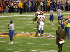 Eric Decker on the Vikings logo at midfield (rburtzel) Tags: game home sports minnesota standing logo football media purple nfl minneapolis indoor professional cameras vikings mn turf reporters warmups pregame metrodome midfield minnesotavikings denverbroncos 2011 50yardline december4th 120411 ericdecker mallofamericafield