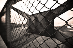 World War 3 (Issa Fakhro) Tags: city sky urban blackandwhite bw sepia contrast canon fence photography lights skne war europe shadows dof sweden bokeh steel wideangle x conflict scandinavia malm worldwar3 roughness ef1635mmf28liiusm filterroughpastels