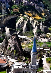 Greme, Nevehir province, Turkey (Chantal Fournier (Bayan Paparazzi)) Tags: blue houses roof mountains streets beauty turkey landscape village view muslim mosque plains speakers cappadocia overview greme blueroof nevsehir nevsehirprovince