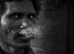 wild gaze (swarat_ghosh) Tags: portrait people india 35mm asian nikon indian smoke smoking hws hardlife d3000 helpportrait swaratghoshphotography