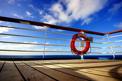 Carnival Ecstasy - Lines (. Jianwei .) Tags: cruise carnival light shadow sea sky cloud sun lines angle wide deck ecstasy 365 railing bahamas 8mm lifesaver a500 jianwei carnivalecstasy kemily