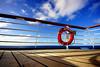 Carnival Ecstasy - Lines (. Jianwei .) Tags: cruise carnival light shadow sea sky cloud sun lines angle wide deck ecstasy 365 railing bahamas 8mm lifesaver a500 jianwei carnivalecstasy kemily