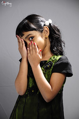 _DSC0164 (Shahir Aboobacker) Tags: red green girl smile face studio child play hand dress flash nail polish shy palm covered half qatar