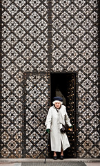 (ssj_george) Tags: street door old woman white church hat cane lady canon lens eos rebel is pattern open squares shapes entrance poland polska krakow xs raincoat cracow f456 55250 55250mm georgestavrinos 1000d ssjgeorge  giorgosstavrinos kiisf